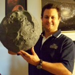 Eric Vandernoot with a paper-mache' model of the asteroid Vesta.